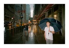 FILM - Flashed (fishyfish_arcade) Tags: 35mm analogphotography canonsureshotz135 filmphotography filmisnotdead istillshootfilm kodak newyork portra400 analogcamera compact film streetphotography umbrella rain