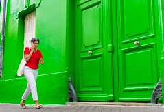 Street - Green #2 (François Escriva) Tags: street streetphotography paris france people candid olympus omd photo rue woman colors sidewalk door windows house green red clothes pants white phone bag glasses