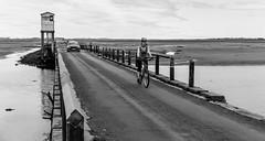 Holy Island causeway . (wayman2011) Tags: colinhart f2 fujifilmxf35mm fujifilmxe2s lightroom5 wayman2011 bw mono coast islands people cyclists northumberland lindisfarne holyisland uk