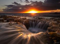 The Devil's Tub (Hilton Chen) Tags: bigisland hawaii kona peleswell algaecoveredrocks colorfulsky dark dramaticsky landscape lavatube leadinglines longexposure moody seascape sunset sunstardd