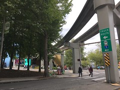 Broad St at 5th Ave N in Queen Anne (Seattle Department of Transportation) Tags: seattle sdot transportation queen anne uptown broad st 5th ave monorail tracks mopop pedestrians trees crosswalk bikeshare bikes sign truck route interstate