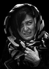 Portrait (D80_538952) (Itzick) Tags: denmark copenhagen candid bw woman face facialexpression streetphotography headgear blackbackground bwportrait portrait d800 itzick