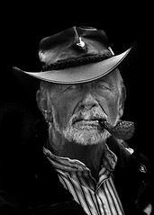 Portrait (D80_539181 - 1) (Itzick) Tags: denmark copenhagen candid bw blackbackground beard hat face facialexpression pipe smoking portrait streetphotography d800 itzick