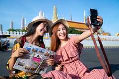 Two asian girlfriends traveling and take photo  selfie in Grand Palace (anekphoto) Tags: bangkok travel asian temple thailand wat woman tourist girl happy buddha asia thai palace grand people vacation tourism religion landmark holiday portrait summer pho traveler ancient buddhism famous architecture chinese phra female lifestyle traditional history worship city trip person beautiful style destination outdoor attraction buddhist walking dress sightseeing look kaew