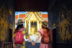 Two asian girlfriends traveling and pass the entrance gate to Grand Palace (anekphoto) Tags: bangkok travel asian temple thailand wat woman tourist girl happy buddha asia thai palace grand people vacation tourism religion landmark holiday portrait summer pho traveler ancient buddhism famous architecture chinese phra female lifestyle traditional door worship city trip person beautiful gate destination outdoor attraction buddhist walking dress sightseeing look kaew