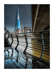Storm Light (Dave Fieldhouse Photography) Tags: london londonbridge shard theshard river riverthames storm water sky skyscraper building buildings architecture handrail bridge stairs steps reflections puddles city cityscape fuji fujifilm fujixt2 wwwdavefieldhousephotographycom weather