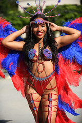 How's This? (Anthony Mark Images) Tags: beautiful beautifulwoman people portrait prettygirl pretty lovely gorgeous goldenchains redbikini redlips redfeathers bluefeathers headress mississauga ontario canada caribbeanfestival socamusic smile sunshine iriemusicfestival nikon d850 flickrclickx masquerader