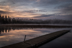 Calm lake (mabuli90) Tags: finland lake forest tree dawn morning sunrise fog mist woods sky clouds water reflection dock pier autumn fall