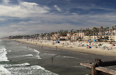 From the Pier (6079 Jones, P) Tags: img2236 canon eos 1200d tamronsp1024mmdiii wideanglelens hoyahrtcirpluv circularpolarizer california usa america oceanside socal cali beach sand ocean sea water pier holiday vacation palm tree waves sky coastal appartments
