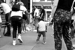 Dynamic Duo (atroche1978) Tags: toronto canada ontario streetphotography candid blackandwhite bw nikon d5600 urban city dslr 35mm dancing child man square