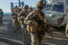 "Marines with the 31st MEU load gear prior to departing the amphibious assault ship USS Wasp (#PACOM) Tags: 31stmarineexpeditionaryunit battalionlandingteam 2ndbattalion 1stmarines combatlogisticsbattalion31 marinemediumtiltrotorsquadron265reinforced marinefighterattacksquadron121 commandelement groundcombatelement logisticscombatelement aviationcombatelement iiimarineexpeditionaryforce amphibiousassaultshipusswasplhd1 amphibioustransportdockussgreenbaylpd20 docklandingshipussashlandlsd48 7thfleet 31stmeu blt21 clb31 vmm262rein vmfa121 iiimef lhd1 lpd20 lsd48 okinawa japan marinecorps indopacific ready partnered lethal marineairgroundtaskforce magtf mv22bospreytiltrotoraircraft f35blightningii ch53esuperstallionhelicopter ah1zviperhelicopter uh1yhvenomhelicopter talismansaber talismansebre ts19 partnershipmatters usindopacificcommand ""usindopacomcoral sea"