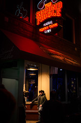 Playing second fiddle (Rabican-BUSY) Tags: nashville tennessee secondfiddle cowboy country bar dude people neon red music streetphotography bouncer hat window happywindowwednesday hww street lights playingsecondfiddle nashvilletn urban city downtown party shadows