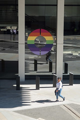 O (Spannarama) Tags: people walking man colourful rainbow pride pridemonth circle o windows reflections sunlight sunshine shadows pavement bollards londonwall londonwallplace london uk lightandshade
