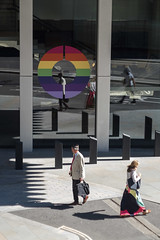 O (Spannarama) Tags: people walking man woman colourful rainbow pride pridemonth circle o windows reflections sunlight sunshine shadows pavement bollards londonwall londonwallplace london uk skirt lightandshade