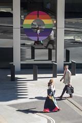 185/365 - O (Spannarama) Tags: 365 july people walking man woman colourful rainbow pride pridemonth circle o windows reflections sunlight sunshine shadows pavement bollards londonwall londonwallplace london uk skirt lightandshade
