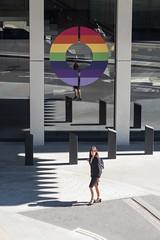 O (Spannarama) Tags: people walking woman colourful rainbow pride pridemonth circle o windows reflections sunlight sunshine shadows pavement bollards londonwall londonwallplace london uk lightandshade