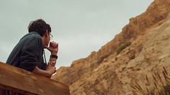 thinking pose (Conny Spandl) Tags: thinking boy eingedi nature rocks desert panaso 45 mm