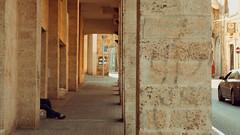 Black vs. Red (Conny Spandl) Tags: homeless street photography red lady jaffa telaviv panaso 45 mm