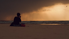 catching the sunset (Conny Spandl) Tags: sunset beach telaviv girl lonely lumix olympus 45mm panaso 45 mm