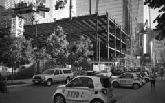 Courtesy, Professionalism, Respect (Miocene) Tags: olympusxa cops nypd minicar ilfordhp5 newyork manhattan crane construction skyscraper finest copcar