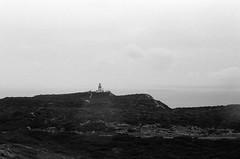 Phare (brnltn) Tags: blackwhite black white argentique analog corse ciel paysage nuage phare mer rocher