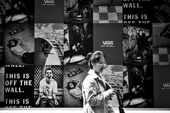 Off the Wall 1 (garryknight) Tags: sony a6000 on1photoraw2018 london themonoseries monochrome blackandwhite snapseed soho woman poster wall street candid