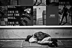 Off the Wall 2 (garryknight) Tags: sony a6000 on1photoraw2018 london themonoseries monochrome blackandwhite snapseed soho man homeless sleep poster wall street candid