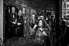 Changes Through the Ages (garryknight) Tags: sony a6000 on1photoraw2018 london themonoseries monochrome blackandwhite snapseed coventgarden woman photo wall street candid
