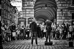 Spell Bound (garryknight) Tags: sony a6000 on1photoraw2018 london themonoseries monochrome blackandwhite snapseed coventgarden streetperformer magician crowd street candid