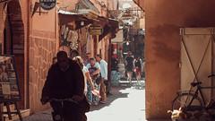 souk life (Conny Spandl) Tags: man bike cycling oldtown medina souk marrakech morocco street photography panaso 45 mm