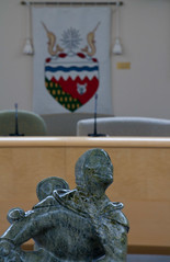 Centre Scuplpture with Coat of Arms In background (J.R. Rondeau) Tags: rondeau nt yellowknife sculpture nwtlegislativeassembly symbols canoneos tamron2875 photoshopelements10