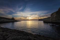 Xlendi Bay Sunset (CraDorPhoto) Tags: canon6d sunset clouds sky blue bay water sea mediterranean sun cliffs coast coastline nature outdoors outside gozo malta