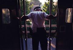 Metra Conductor Holding The Door. (Jovan Jimenez) Tags: nikon gold 200 fm3a metra conductor holding the door seriese 35mm f25 kodak film analog analogue eseries plustek opticfilm 8200i