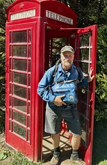 Knocking Around Knockando (rich_brame) Tags: man backpack beard satchel phonebooth red blue scotland knockando