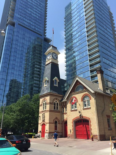 Fire station hose/watch/clock tower dwarfed by condos