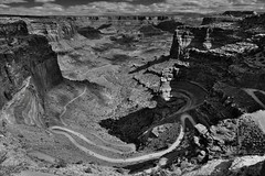 The Curves of Shafer Canyon Road and a Leading Line off into the Distance... (Black & White, Canyonlands National Park) (thor_mark ) Tags: azimuth61 blackwhite blueskies bluesskieswithclouds butte canyon canyonwalls canyonlands canyonlandsnationalpark canyons capturenx2edited centralcanyonlands colorefexpro coloradoplateau day5 desertlandscape desertmountainlandscape dirtroad highdesert intermountainwest islandinthesky islandintheskydistrict lasalmountains landscape layersofrock lookingne mesa nature nikond800e outside partlycloudy portfolio project365 road shafercanyon shafercanyonoverlook shafercanyonroad silverefexpro2 sunny unimprovedroad utahhighdesert utahnationalparks2017 whiterimroad windingroad utah itedstates