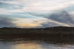 As the Sun Fades at Lime Lake (matthewkaz) Tags: lake limelake sunset clouds sky lakelife reflection reflections water summer leelanau michigan puremichigan 2019 trees house maplecity cedar