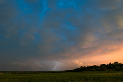 Lightning Sunset (cowgirljo78) Tags: lightning storms storm thunder sunset skies sky alfalfa fields valley marengo sanborn penokeemountains wisconsin stormy sunlight clouds evening pink blue yellow