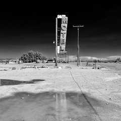 motel / route 66. mojave desert, ca. 2014 (eyetwist) Tags: eyetwistkevinballuff eyetwist mojavedesert motel neon sign decay abandoned route66 henning henningsmotel newberrysprings newberry springs bagdad california deserted lonely bypassed closed nikkor nikon d7000 nikond7000 18200mmf3556gvrii square bw black white monochrome blackwhite processed postprocessed plugin alienskinexposure niksilverefex contrast baghdad cafe landscape american west barstow derelict roadsideamerica americana route 66 motherroad rusty weathered type typography typographic classic vintage mojave desert reflection puddle water