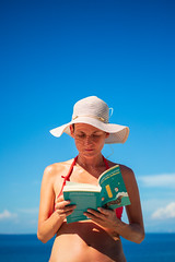 The reader (Davide Gabino (aka Stròlic Furlàn)) Tags: woman beauty book read reading sun hat hands sky summer holiday break