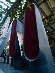 A Buildings Lungs (Steve Taylor (Photography)) Tags: city uk greatbritain blue red building tree green london leaves grid branch shapes gb vents struts bollards unitedingdom