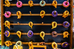 Churros and doughnuts hanging on wooden shelf (wuestenigel) Tags: products vibrant digitalnomad tasteful healthy tasty food baked photography reiseblogger stockphoto design delicious fresh display pastry churros iron eisen old alt lock sperren wood holz antique antiquität traditional traditionell retro noperson keineperson steel stehlen symbol desktop security sicherheit door von gate tor decoration dekoration ancient uralt pattern muster ornate aufwendig texture textur