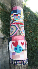 Yarn bomb totem pole by the Seine (Monceau) Tags: yarnbomb totem totempole seine cheerful colorful tree whimsical knit crochet