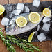 Dorado or sea bream fish with lime and lemon slices and sprigs of rosemary. Mediterranean cuisine. Top view