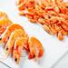 Boiled shrimp of different sizes on white background