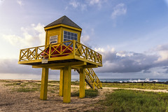 Barbados morning (mystero233) Tags: barbados morning sunrise dawn beach holiday island caribbean bridgetown house architecture building yellow paint wooden sea ocean atlantic waves rocks sky blue clouds landscape outdoor nature travel