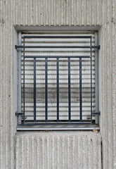 Shutters, bars and lined gray walls - get the message? (Monceau) Tags: shutters horizontal bars vertical gray walls lines monochrome