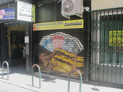 Gold  dealer's,  Calle  Eugenio  Salazar,  Prosperidad,  My  Neighbourhood.  Madrid (d.kevan) Tags: businesses rolldownshutters paintings closed prosperidad myneighbourhood madrid buildings golddealers ingots banknotes calleeugeniosalazar coins doorways languageschool poultryshop