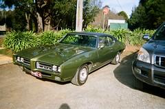 1969 Pontiac GTO (Matthew Paul Argall) Tags: kodakflashsingleusecamera 35mmfilm disposablecamera singleusecamera 800isofilm kodak800 car vehicle automobile transportation classiccar pontiacgto carspotting vinylroof