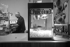 Stadtkino Grein (kuuan) Tags: voigtländerheliarf4515mm manualfocus mf voigtländer15mm aspherical f4515mm superwideheliar apsc sonynex5n kino grein popcorn bw austria entrance cinema cinemahall vintage stadtkinogrein